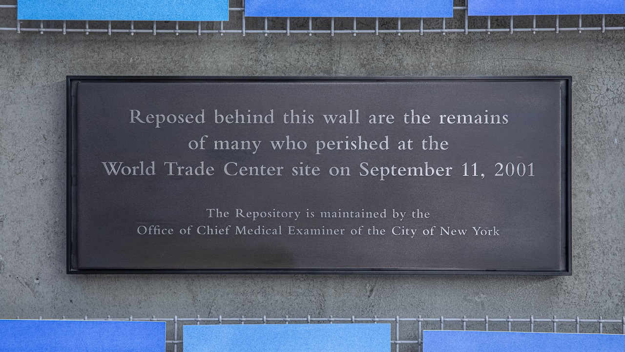 "A plaque on the wall beside artist Spencer Finch's installation ""Trying To Remember the Color of the Sky on That September Morning"" in Foundation Hall reads: ""Reposed behind this wall are the remains of many who perished at the World Trade Center site on September 11, 2001. The Repository is maintained by the Office of Chief Medical Examiner of the City of New York."""