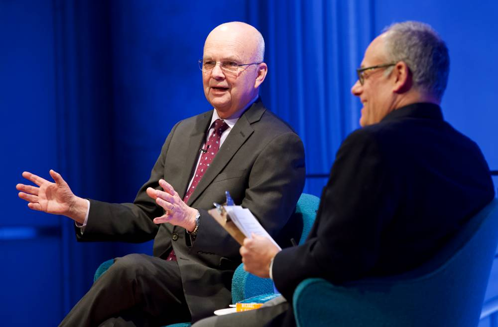 Former CIA director and retired U.S. Air Force Gen. Michael Hayden gestures onstage as part of the public program, General Michael Hayden on the War on Terror.