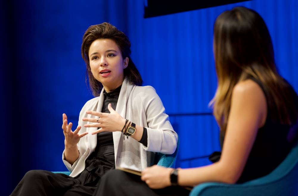 VICE correspondent Isobel Yeung gestures onstage as she takes part in the public program, VICE on HBO: After the Fall.
