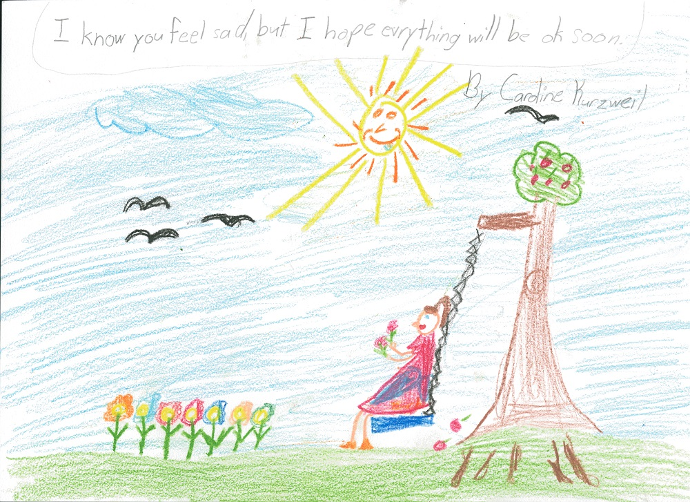 "A child's drawing depicts a girl on a tree swing. The girl is holding flowers she's picked. More flowers are coming out of the ground. Several birds are flying by a sun with a smiling face. A message written at the top reads: ""I know you feel sad, but I hope everything will be OK soon."""