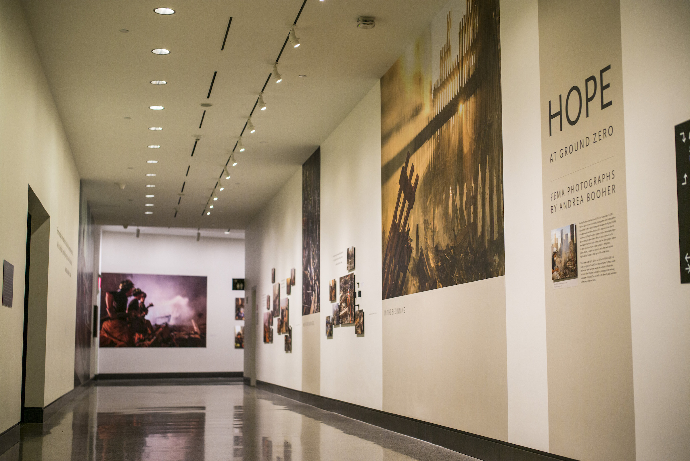 A collection of photographs documenting the work of dedicated men and women at Ground Zero after 9/11 are displayed as part of the exhibition Hope at Ground Zero: FEMA Photographs by Andrea Booher.