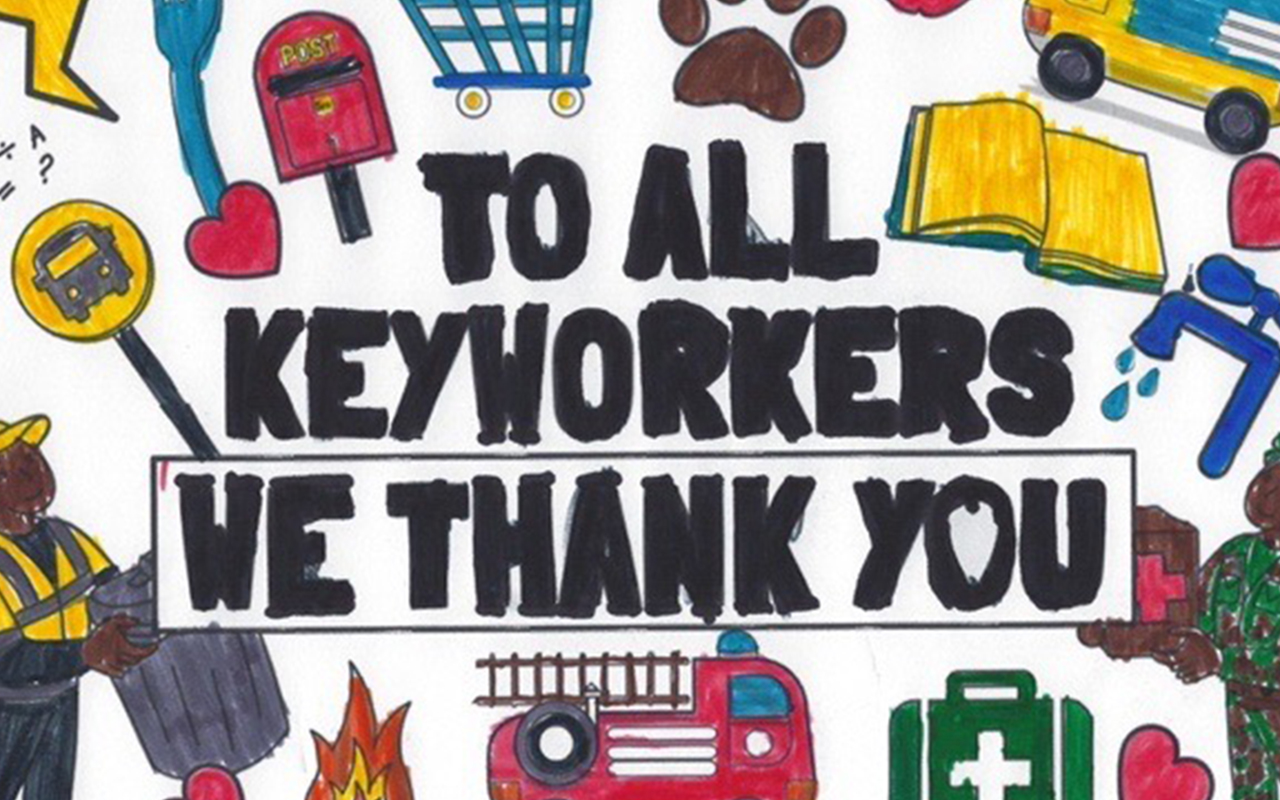 "A hand-drawn poster reads ""To All Keyworkers, We Thank You.""   The slogan is surrounded by drawings of a sanitation worker, fire truck, a shopping cart,  medical instruments and other tools of fronline workers."