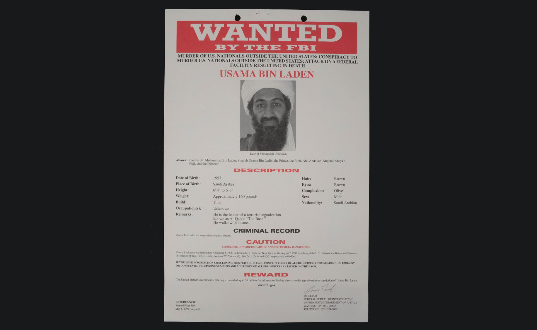 FBI wanted poster for Osama bin Laden. It includes a black and white photo of bin Laden and his physical description.