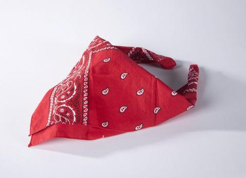 A red bandana that belonged to Welles Crowther is displayed on a white surface at the Museum.