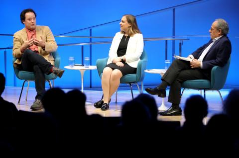 Author Graeme Wood and George Washington University research fellow Devorah Margolin speak onstage at the Museum auditorium.