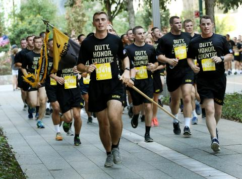 Dozens of West Point cadets in running outfits take part in the Tunnel to Towers 5K Run and Walk.