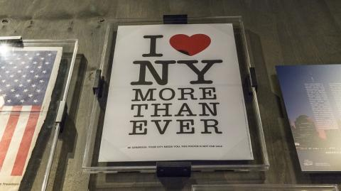 "The ""I Heart NY More Than Ever"" poster hangs in the 9/11 Memorial Museum's historical exhibition gallery."