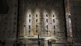 The concrete slurry wall is seen lit up in Foundation Hall.