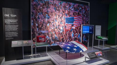 An American flag and other memorabilia is on display as part of the sports-themed exhibition Comeback Season: Sports After 9/11.