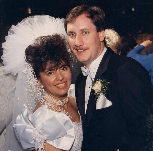 Monica Rodriquez and her husband Edward Smith pose for a photo during their wedding.