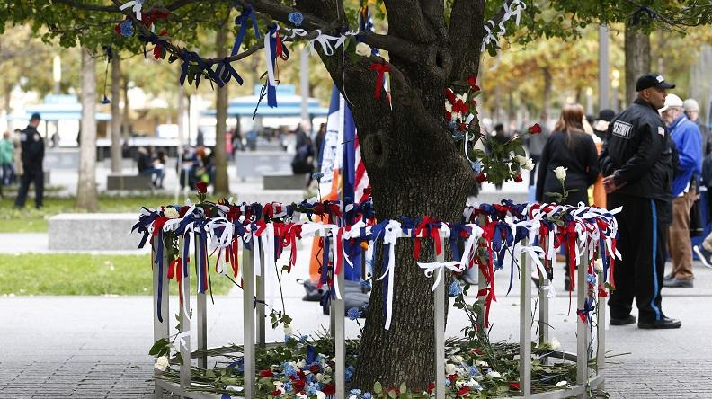 Visitors leave tribute ribbons of red, white, and blue at the Survivor Tree after the terrorist attacks in downtown Manhattan on Wednesday, Nov. 01, 2017.