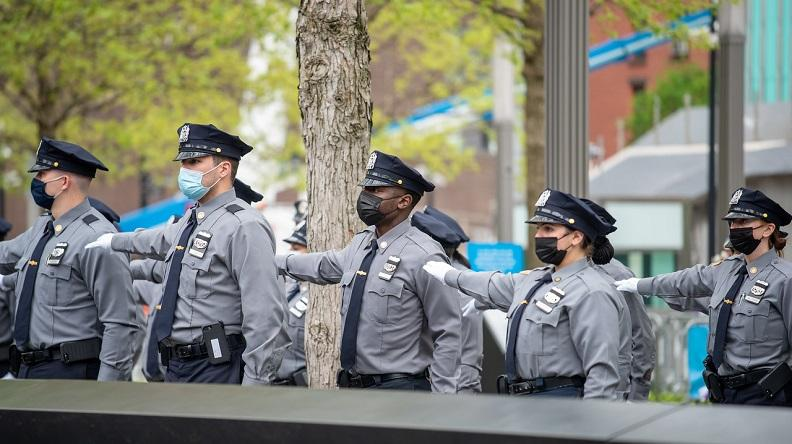 NYPD recruits stand at arm's length on the Memorial plaza during a recruitment ceremony.